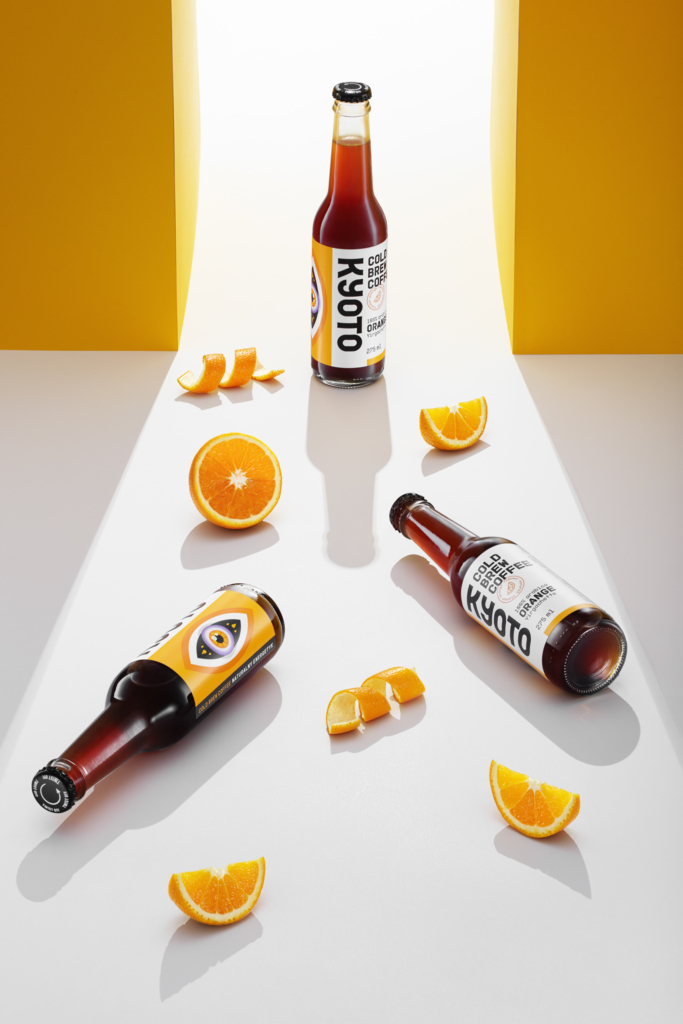 advertising photography of coffee drink in bottle on orange backgroud