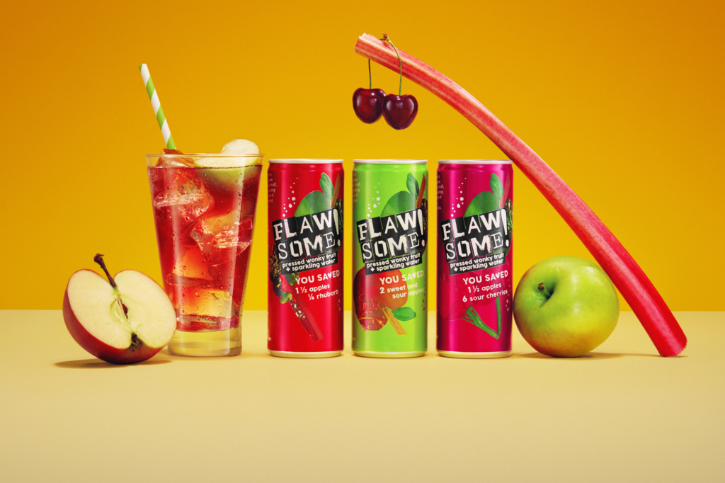 Juice in cans with drink in glass and fruits