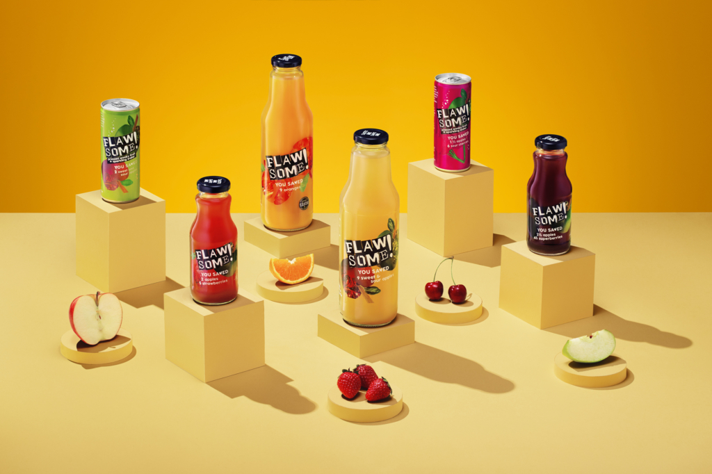 creative photo on yellow background with botlles, cans and fruits